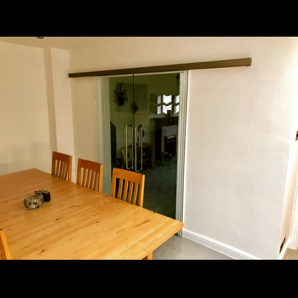 West midlands interior glass sliding doors for Sliding walls residential